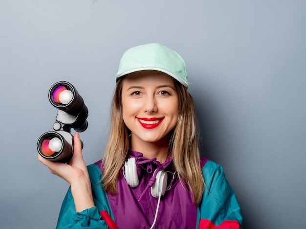 Woman in 90s clothes style with binoculars
