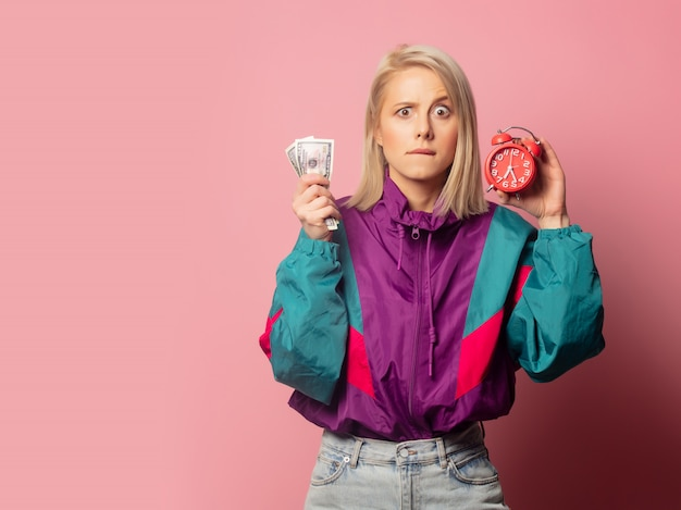 Woman in 90s clothes with alarm clock and cash