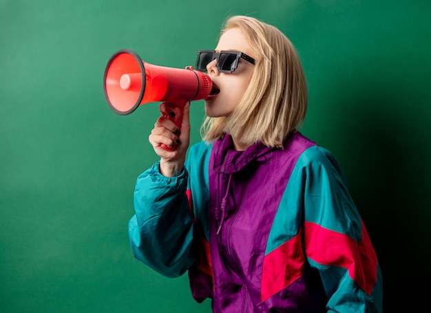 Woman in 90s style punk jacket with loudspeaker