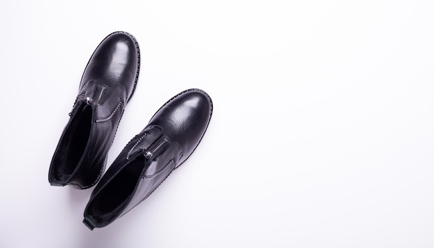 Woman accessory. black stylish boots. top view. flat lay.
