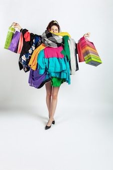 Woman addicted of sales and clothes, overproduction and crazy demand