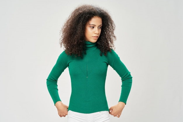 Woman african american in a t-shirt posing