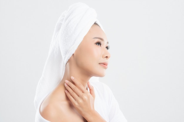 Woman after bath with clean perfect skin on white background.