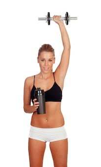 Woman after her training, drinking protein shake and with an apple