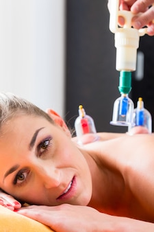 Woman in alternative medical cupping therapy