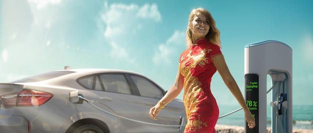 여자와 전기 자동차 충전. 고품질 사진