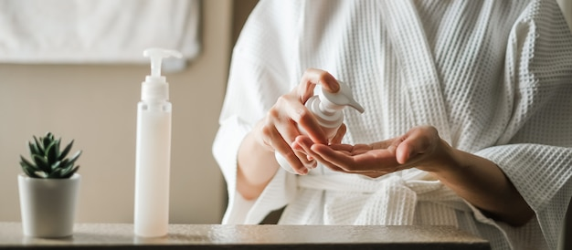 Woman apply the skincare gel in the bathroom.