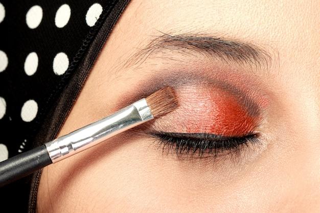 Woman applying eye shadows
