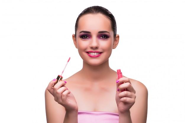 Woman applying lipstick isolated