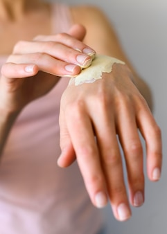 Woman applying lotion on her hands