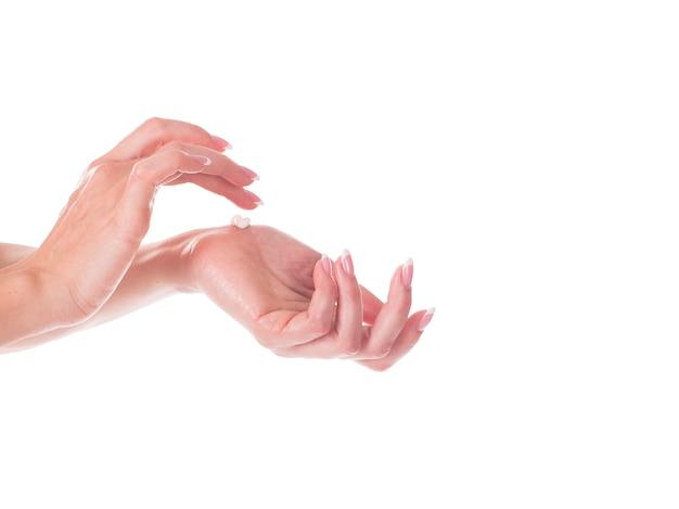 Woman applying moisturizing cream on her hands