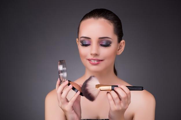Woman applying shadows  in beauty