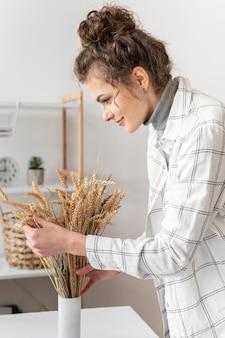 Woman arranging plants medium shot