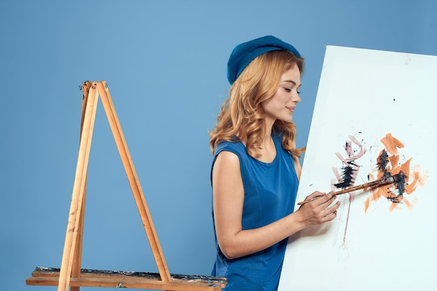 Woman artist tail hand brush drawing art creative lifestyle blue