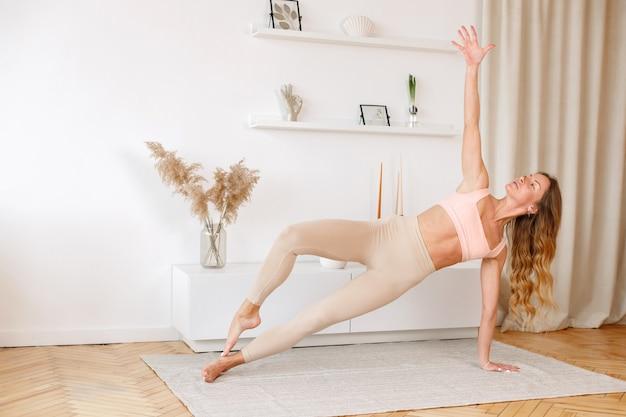 Woman in asana yoga house