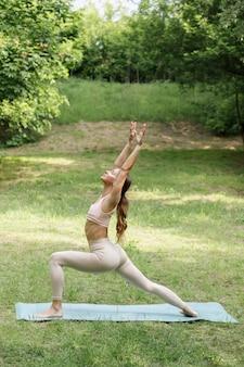 Woman in asana yoga summer in the park