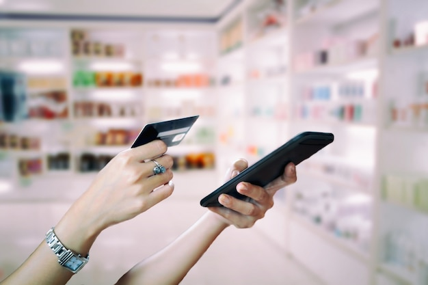 Woman asian using smart phone and credit card shopping online