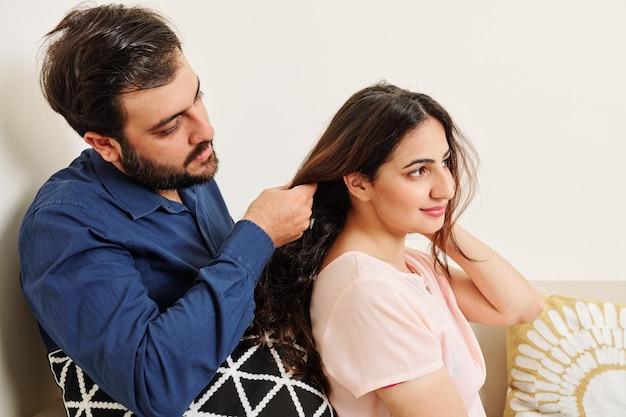 Woman asking boyfriend to braid her hair