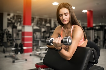 Woman at gym body building
