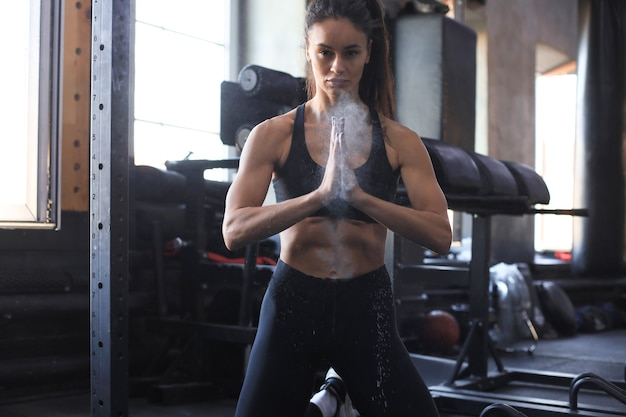 Woman athlete getting ready for crossfit training.
