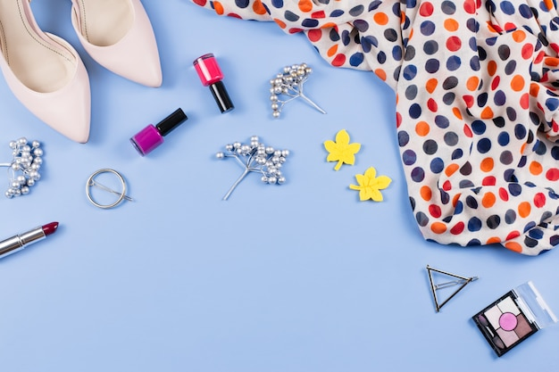 Woman autumn clothes, cosmetics and accessories flat lay. female fall fashion concept. top view