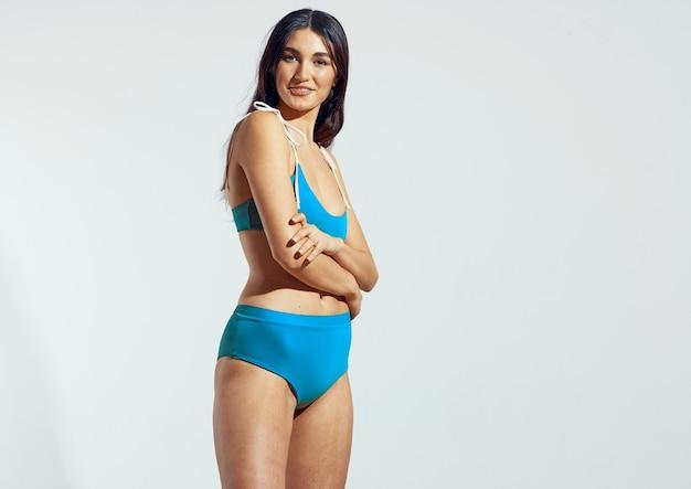 Woman autumn swimwear beach bag summer posing bikini luxury