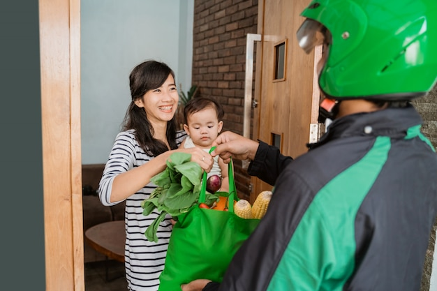 Woman and baby shopping grocery online