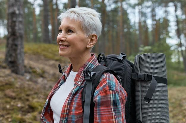 Woman backpacker enjoying active weekends outdoor.