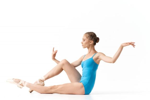 Woman ballerina dancing ballet in the studio
