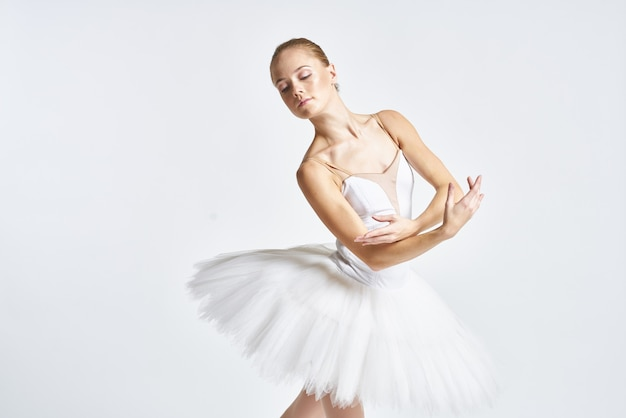 Woman ballerina dancing in tutu and pointe shoes