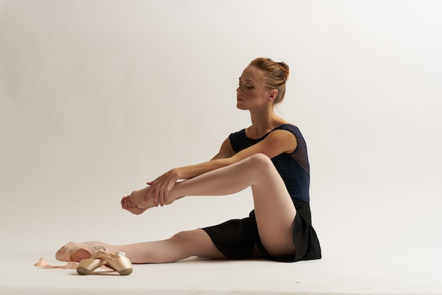 Woman ballerina is stretching