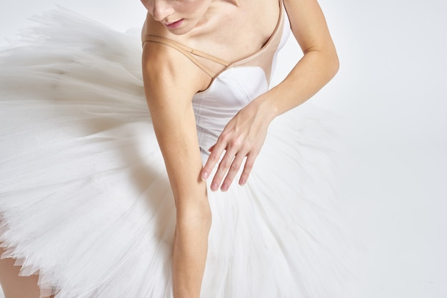 Woman ballerina white tutu performing dance
