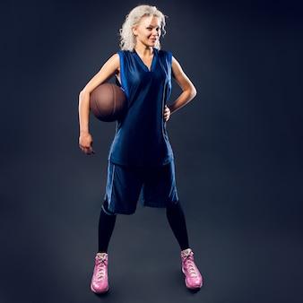 Woman basketballer in blue jersey