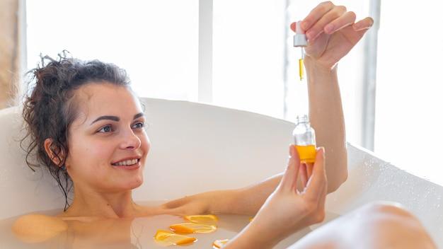 Woman in bathtub taking bath