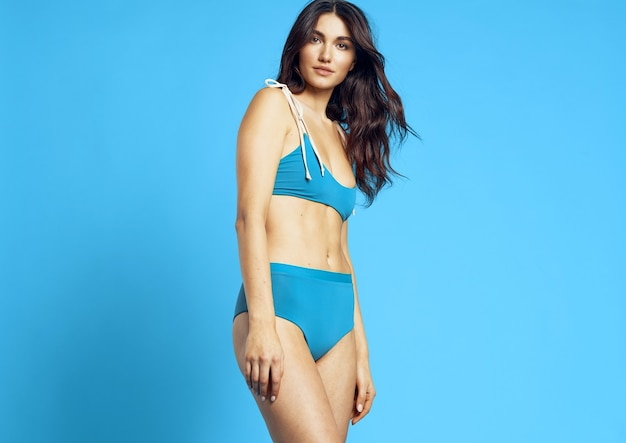 Woman in beach bikini palm leaf glamor posing. high quality photo