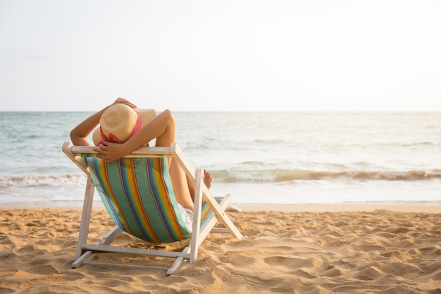 Woman on beach in summer tanning