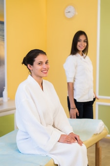 Woman beautician doctor with patient in spa wellness center.