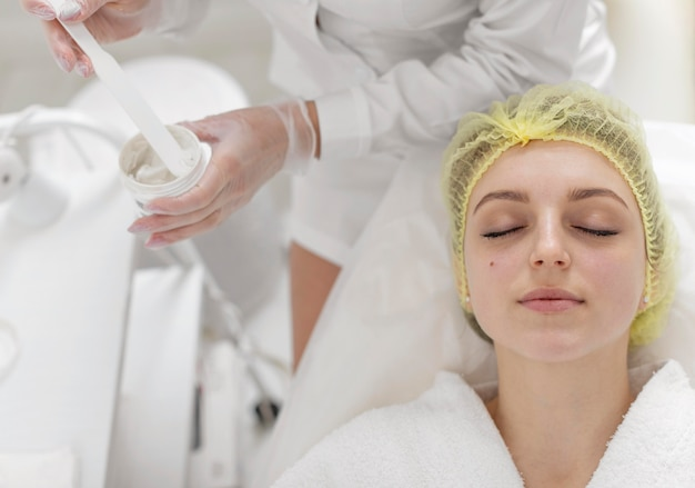 Woman at beauty clinic for face treatment