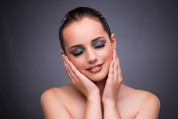 Woman in beauty concept on gray background