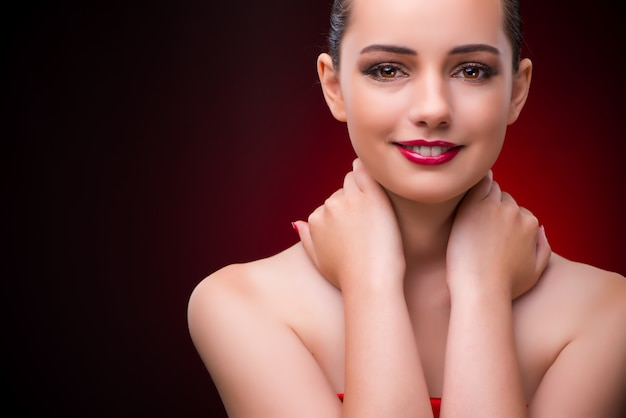 Woman in beauty concept with red lipstick