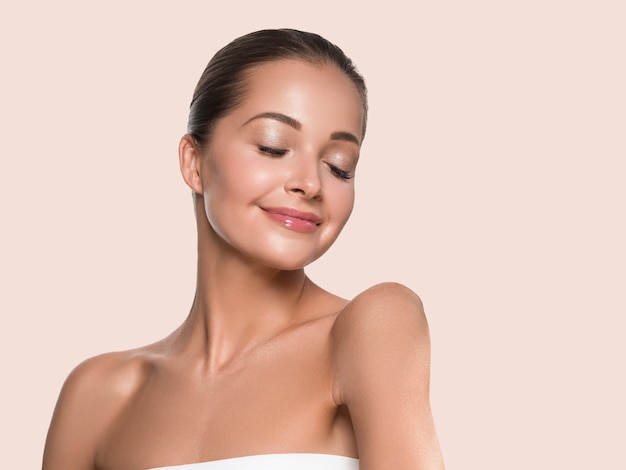 Woman beauty face healthy skin natural makeup beautiful young model. color background. yellow