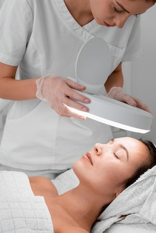 Woman at beauty salon for face treatment