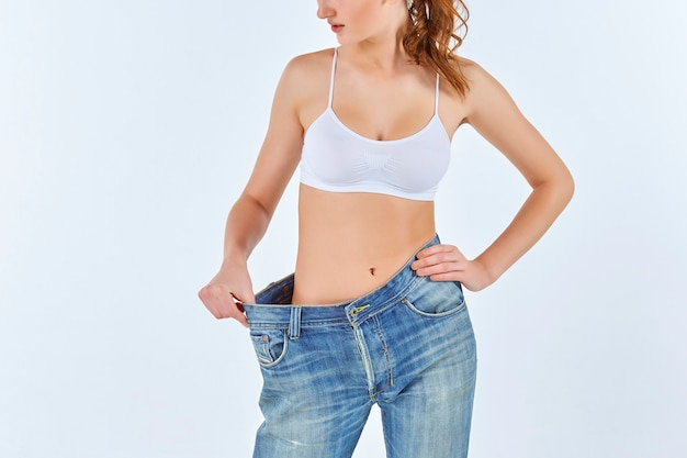 Woman became skinny and wearing old jeans