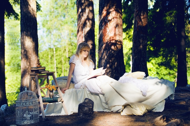 Woman in a bed in the forest