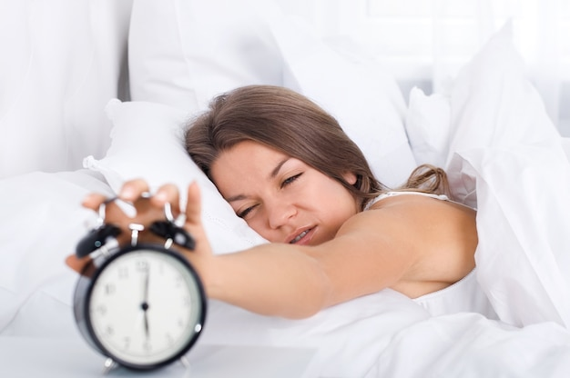 Woman in bed waking up