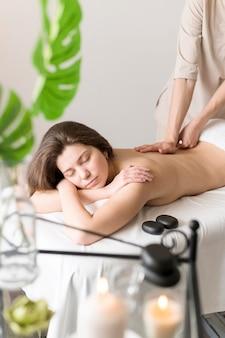 Woman being massaged