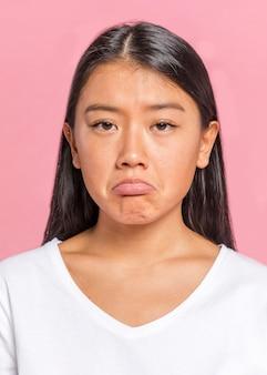 Woman being sad and looking at camera