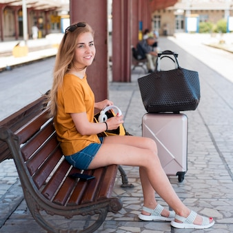Woman on bench in train station