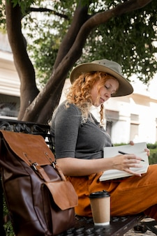 Woman on bench writing in journal