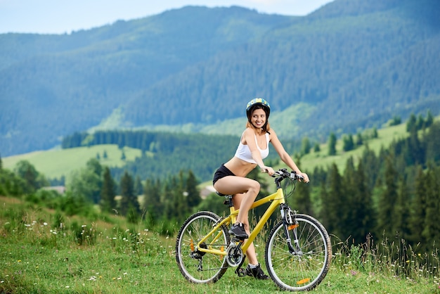 Woman bicyclist in the mountains